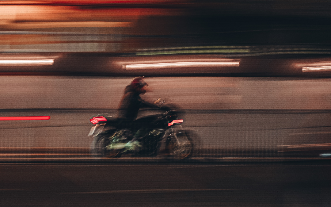 image of motorcyclist that is blurred due to movement